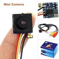 Cámara de vídeo mini caja de circuito cerrado de televisión Baratos-Mini CCTV 600TVL de la cámara CCTV de la CCTV de la CCTV de la seguridad casera de la cámara de la cámara del oído del agujero de alfiler NTSC / PAL con la caja al por menor