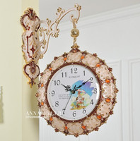 Wholesale Luxury clock horologe creative fashion living room European style double sided wall clock hanging horologium mute metal decorate clock