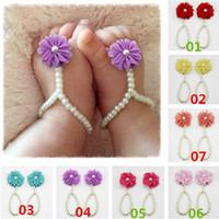 Precio de Sandalias de perlas flores-El pie del niño del bebé de las nuevas llegadas acalma el primer caminante de las sandalias descalzas el primer calza la gasa 13CM GA411 de la resina de la flor de las perlas que envía libremente
