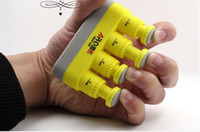 Wholesale 100pcs Fingers Trainer tools Musical Instruments Piano Bass Guitar Finger Hand Exerciser Extend O Grip Trainer Han DHL EMS UPS free ship