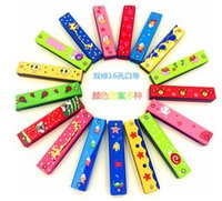 Wholesale Children musical instruments Children s cartoon wooden harmonica harmonica infant early childhood educational toys double hole