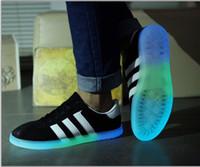 Wholesale Shoe soles luminous night club Couple shiny shoes stars luminous fluorescent shoes casual men s shoes sports shoes