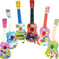 Wholesale Children s toys guitar fancy early childhood music toy four small guitar string simulation can play an instrument