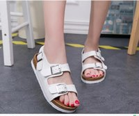 Wholesale Selling Cork sandals slippers summer female Korean couple thick crust flat heel buckle word slippers sandals in black and white