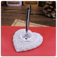 élégant porte-stylo rose de plumes gros-blanc pour la société de mariage