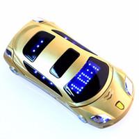 Nouveau téléphone mobile de voiture de mode débloqué pour l'homme étudiant meilleur téléphone portable cellulaire en acier de métal de style de voiture cadeau double carte SIM Livraison gratuite