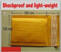 12 * 16 cm de papel Kraft sobre del correo del bolso de la burbuja de PE bolsos rellenados envío 100pcs suministros de embalaje / lot