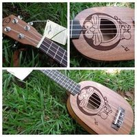 Wholesale 21 inch cartoon Viking paragraph ukulele Hawaii small four string guitar