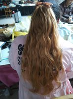 Wholesale golden wavy human hair claw in pony tail fully machine made all lengths are availlable in stock No shedding and tangling