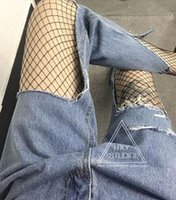 america jeans - Harajuku America Style Ripped Holes Vintage Water Wash Women s Sexy Jeans And Fishnet