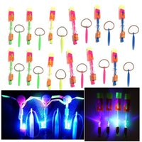 arrow rotate - 12Pcs Amazing LED Light Arrow Rocket Helicopter rotating Flying Toy Party Fun Gift Blue light K5BO