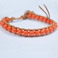 Wholesale Synthetic resin imitation red coral pure manual weaving lap leather cord bracelet popular beautiful beautiful youth woman bracelet joker
