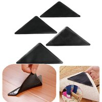 Wholesale 4pcs A Reusable Rug Carpet Mat Pad Grippers Ruggies Grip Sticky Non Slip Washable Black Hot Sale