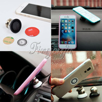 Wholesale Newest black and white Hot Sale For Mobile Phones and Car GPS Universal Mini Magnetic Sticky Mount Stand Holder