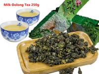 al por mayor regalo chino del té verde-Té de Oolong de la leche de la promoción 250g Té Taiwán de Taiwán de la alta calidad Taiwán Montañas de Taiwán que adelgazan el té del cuidado médico del té, regalo secreto