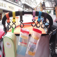 Wholesale New Plastic Baby Stroller Accessories Pram Hooks Pushchair Car Hanger Hanging Strap Random Color High Quality