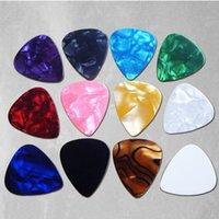 Wholesale electric guitar picks plectrums all shorts of color options guitar parts pearl guitar pick shape