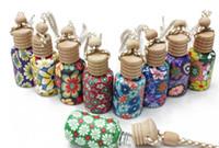 Wholesale 300pcs ml Car hang decoration Ceramic essence oil Perfume bottle Hang rope empty bottle random colors styles D906