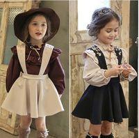 Wholesale Long Cotton Skirt Fashion - 2016 Korean Fashion Children Girls Flouncing Puff Long Sleeve Shirt +Suspender Skirt 2 pcs Outfits Set Little Princess Suits B4264