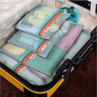 bedding compression pack - 4 Set Mesh Travel Bag Organizer Set Travel Luggage Packing Mesh Pouch Organizer Storage Bag Zipper Clothes Storage Bag