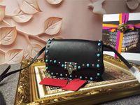 designer - Famous Designer brand Rockstud Rolling bag Women High quality Genuine leather Rivet shoulder bags Fashion ladies luxury messenger bags