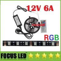 al por mayor pcb uk-Negro PCB 5050 RGB LED luces de tira impermeable 12V los 5M / 12V 6A Los conductores de energía Kit + Control Remoto + 44key UE de los EEUU Reino Unido del enchufe del AU