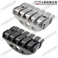 Wholesale Black and silvery metal suspending style MM no headstock guitar nut string lock device