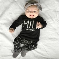Cheap Fashion baby girl clothes sets 2016 spring infant black cotton long-sleeved letter milk printed T-shirt+pants newborn baby boy clothing set