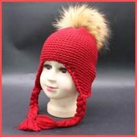 baby beach products - New Unique Design Girls Raccoon fur ball Pom Poms Winter Cap Wool Knitted Bomber Hat Crochet Baby Hats Baby Products Beanie