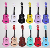 Wholesale Musical instruments early childhood enlightenment guitar practice guitar inch wooden guitar children guitar ukulele small adjustable play