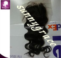 Wholesale best quality cheap price body wave black Indian hair top closure baby hair swiss lace