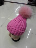 Wholesale Striped Genuine fur pom poms beanie hat Winter warm knitted hat with fur ball