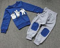 Nueva ropa de otoño de los niños conjunto niños deportes trajes niños trajes bebé ropa de piedra de la manera tijeras juego de tela impreso
