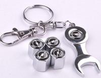 achat en gros de mini-trousseau de roue de voiture-4pcs / Pack Car Wheel Tire Valve Caps avec Mini Clé Keychain pour Opel Auto Accessoires