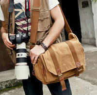 Wholesale Factory direct sales of New Retro Crazy Horse Leather Canvas Shoulder Messenger Bag retro casual portable SLR photography anti theft camera