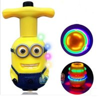 Wholesale The new flash top small yellow people gyro colorful light music top thief daddy birthday gift