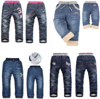 Wholesale Children s clothing autumn and winter thickening child trousers child plus velvet jeans winter plus velvet thickening