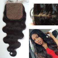 Cheap 9A Cheap Silk Base Closure 4x4 Bleached Knots Unprocessed Brazilian Virgin Hair Body Wave Closure 8-22inch