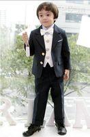 Solo botón abrigos negros España-muchacho caliente de las ventas se adapte a la solapa negro sola fila flores niño se adapte a dos botones de dos piezas (chaqueta y pantalón)