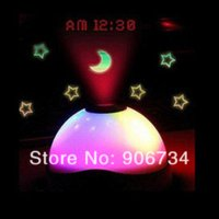 Wholesale New Projection Projector Alarm Table Clock Color Change LED Star Night Light Magic Desk amp Table Clocks