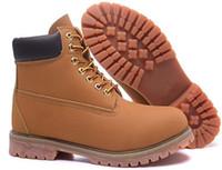 Los cargadores al aire libre de las mujeres de los hombres del cuero genuino del 100% calzan los cargadores militares impermeables de los cargadores de la nieve de los cargadores que van de excursión los zapatos