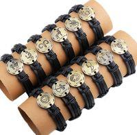 achat en gros de gravés bracelets en cuir femmes-12pcs / lots Livraison gratuite Bracelets en cuir gravé hommes / femmes hommes bracelets main-tricoté zodiaque cadeau