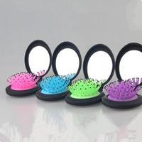 Moda anti-estática cepillo portátil Mini plegable peine bolsas de aire de las niñas de masaje ronda pelo cepillo de pelo con espejo lindo pelo peine
