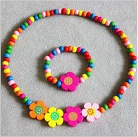 Cheap 2pcs set Colorful Wood Beads Cute Girl Flower Necklace and Bracelet Children Jewelry Set FD100