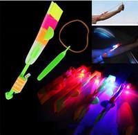 Wholesale LED Light Up Amazing Flying Sling Arrow Helicopter Rocket Parachute Frisbee
