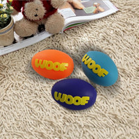 Wholesale WOOF Rugby Ball Pet Squeak Rubber Toy Dog Molars Good Quality Fun Bite And Chew Squeaker Ball Toy L039