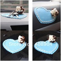 Wholesale Cartoon car non slip pad bear slip pad saw doll car mobile phone slip resistant pad