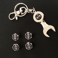 Wholesale New Hot Sale Car Styling Car Wheel Tire Valve Caps with Mini Wrench Keychain Keyring for Nissan Pack