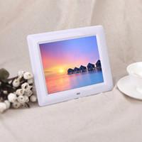 achat en gros de images haute résolution-En stock! Cadre photo numérique haute résolution LCD 7 pouces MP3 / 4 Alarme + Prise USB à distance Noir / Blanc Couleur Le plus récent