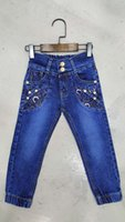 Wholesale Waist elastic waistband button after breaking off trousers Slim female Tong Chunqiu models lace blue jeans